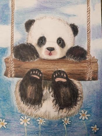 Joanna Wągrowska - panda na drewnianej huśtawce